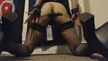unshaved arse jiggling in fishnet stocking and high.