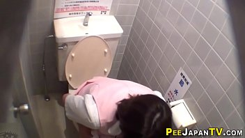 uniformed japanese pissing