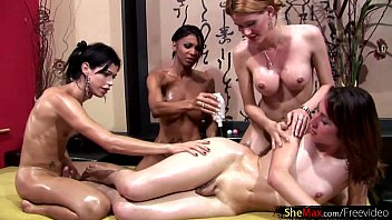 four trannies decorate each other in oil before anal