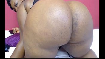 dark-hued plus-size on web cam stretching and winking.