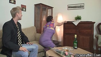 older grannie in tights is smashed on the couch