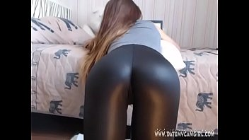 leather dame belindatight12 showcasing glossy booty.