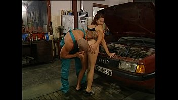 mature damsel is porked in a garage by mechanic