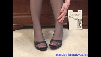fjf daisy models her feet and gams in.