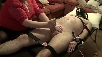 masked roped to the couch edged then made.