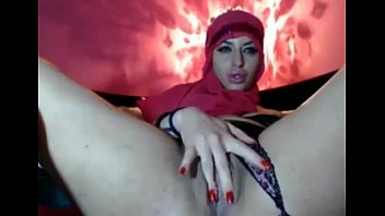 a chechen hijabi lady tugging in.