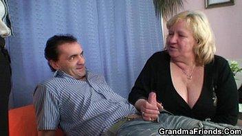 towheaded grandma gets stuffed by two.