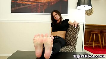 pedicured she-masculine taunts us with her.