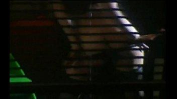 Girl Stripping in Window
