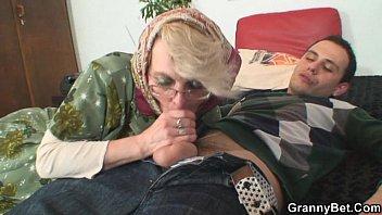 granny sates an youthful boy