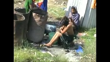 indian village ladies bathing nude in open caught.