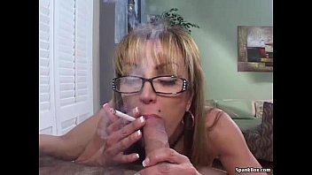 mature smokes ciggie while deep throating.
