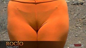 pretty dark haired gal with orange.