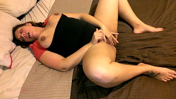 gwen odel toying with her beaver on couch four
