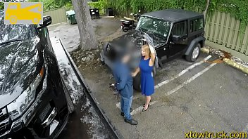 mature cougar offers hand-job to a tow car.