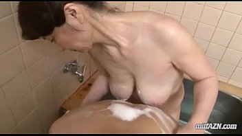 mature girl washing youthful dude figure throating his.