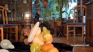 mature model doris dawn plays with balloons and.
