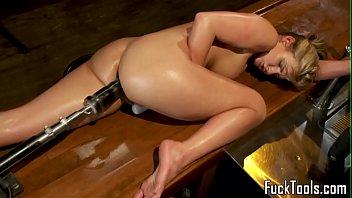 Busty babe stuffed by massive dildo