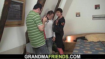 elderly gal in crimson undergarments guzzles.