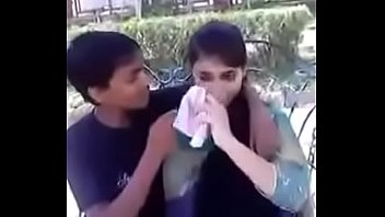 indian teenie smooching and pressing hooters.