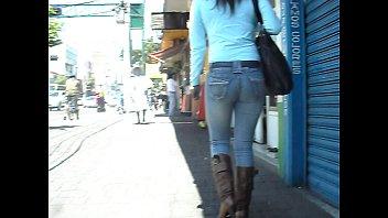 girld ambling on the sidewalk