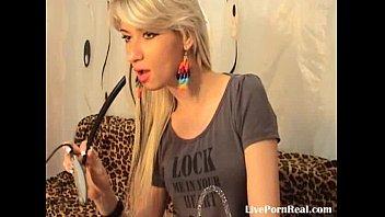 beautiful blond frigging herself on a.