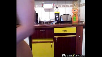 blond woman bare in the kitchen