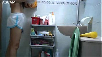hiddencam youthful lady in rest room