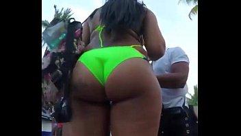 candid - extraordinaire dark-hued bum in green bathing suit