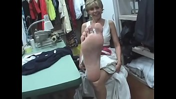 unsuspecting seamstress with very marvelous feet.