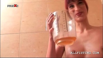 ginger-haired mega-slut drinking her pee from a ample cup