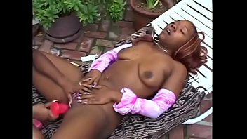 two black chicks have fun with strap on.