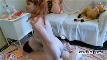 redhaired sweetheart sunshine pipe plays with plush plaything.