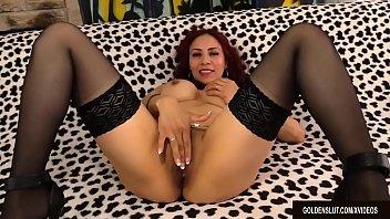 mature latina claudia fox plays with her muff.