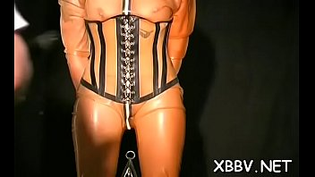 corpulent gal roped up and coerced to suffer.