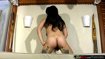 latina femboy peels off off crimson sundress and.
