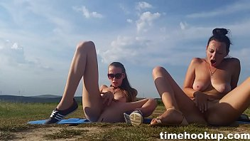 two youthful ladies fap outdoors